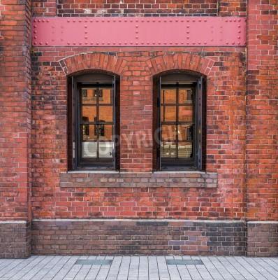 Papiers peints Fenêtres dans un mur de briques rouges fond