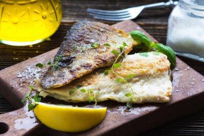 Papiers peints Filet de poisson à l'huile d'olive et au citron
