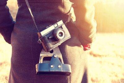 Papiers peints Fille avec la caméra vintage rétro.