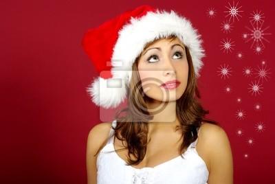 Fille de Noël sur fond rouge