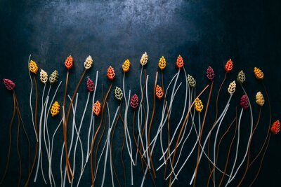 Papiers peints flowers composition made out of colorful pasta on the dark  table, topview