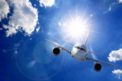 Papiers peints Flugzeug dans Sonne und Wolken