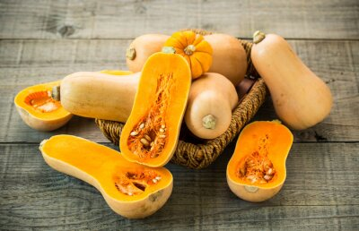 Fresh butternut squash on the wooden table