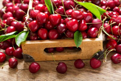 fresh cherries in a wooden box