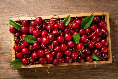 fresh cherries in a wooden box, top view