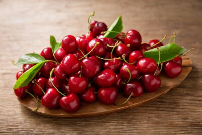 fresh cherries on a wooden table