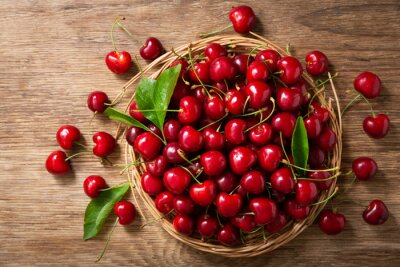 fresh cherries on a wooden table, top view