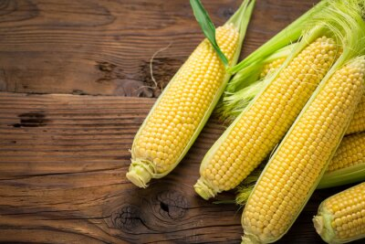 Fresh corn on cobs on the wooden table