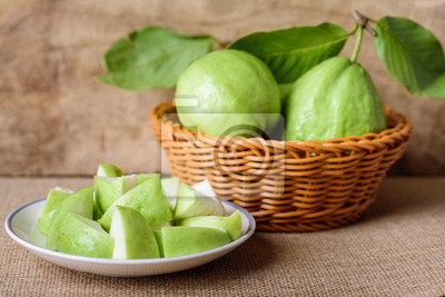 Fresh guava fruit on wooden background