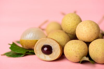 Fresh longan fruit on pink background, Tropical fruit