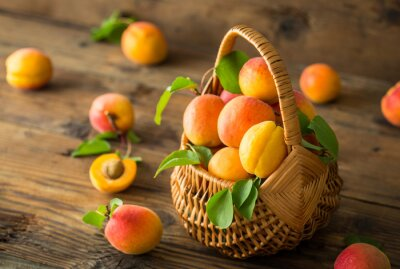 Fresh organic apricots on the wooden table