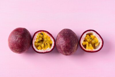 Fresh passion fruit on pink background, top view