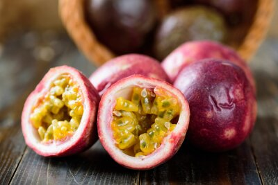 Fresh passion fruit on wooden background, tropical fruit
