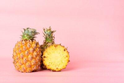 Fresh pineapple fruit on pastel pink background, Tropical fruit