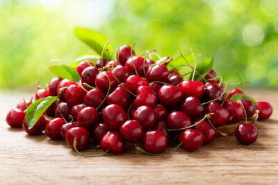 fresh ripe cherries on a wooden table