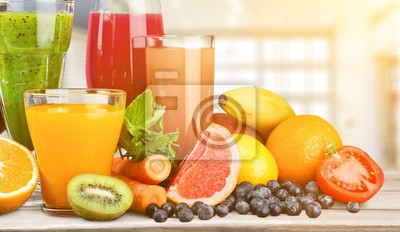 Fresh ripe healthy fruits and juices in glasses