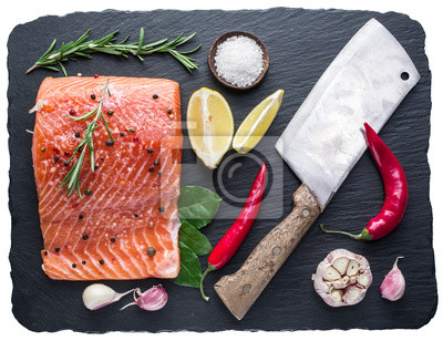 Fresh salmon on the black cutting board. File contains clipping