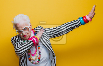 Papiers peints Funny grandmother portraits. Senior old woman dressing elegant for a special event. granny fashion model on colored backgrounds