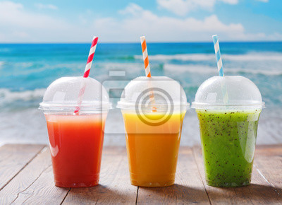 glasses of fruit juice and smoothie