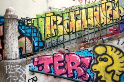 Papiers peints graffitis colorés sur un mur