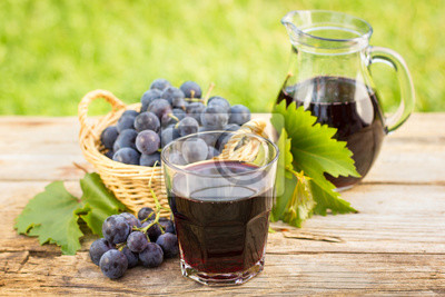 Grape juice in the glass and pitcher
