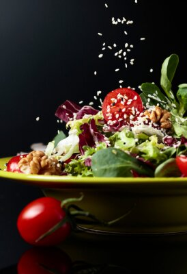 Green salad with cherry tomatoes,  sesame, walnuts and vegetable oil.