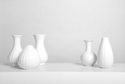 Group of elegant white vases in a white interior