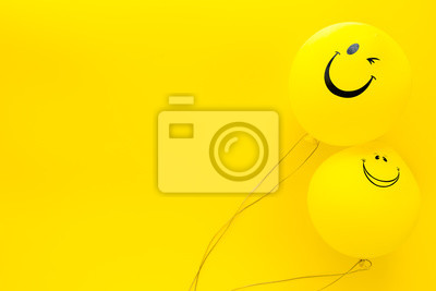 Papiers peints Happiness emotion. Yellow balloon with smile on yellow background top view space for text