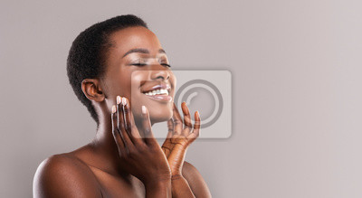 Papiers peints Happy afro woman touching soft smooth skin on her face