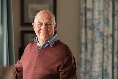 Papiers peints Happy senior man looking at camera at home