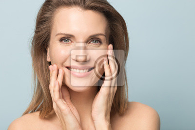 Papiers peints Head shot portrait smiling woman touching perfect smooth face skin