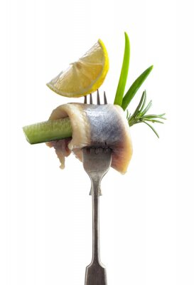 Herring fillet in oil  with lemon, green cucumber, onion and rosemary.
