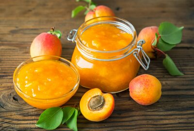 Homemade apricot jam in the jar and bowl