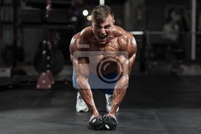 Papiers peints Homme musculaire qui s entraine dans la salle de gym  exerçant des exercices 0dd615c0e59
