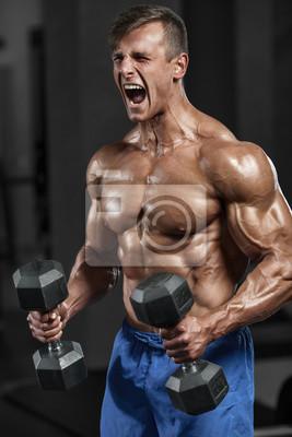 Papiers peints Homme musculaire qui s entraine dans la salle de sport  exerçant des exercices 713ccea6ca2
