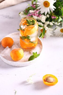 ice tea lemonade with fresh apricots and mint