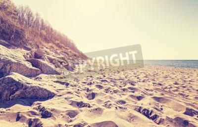 Papiers peints Image vintage tonique d'une plage au coucher du soleil.