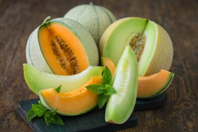 Juicy ripe melons on the wooden table