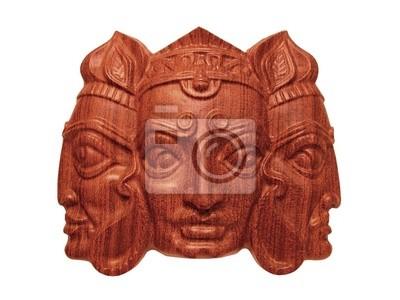 Le masque en bois de dieu indien Trimurti isolé sur blanc