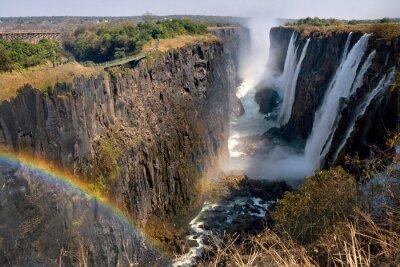 Papiers peints Les chutes Victoria. Une vue générale d'un arc-en-ciel. Parc national. Parc national de Mosi-oa-Tunya. Et site du patrimoine mondial. Zambiya. Zimbabwe. Une excellente illustration.