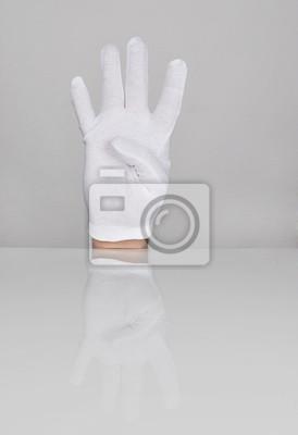 Main avec quatre doigts pointant vers le haut.