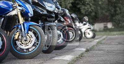Papiers peints motorcycles standing in the row on asphalt closeup. Selective focus