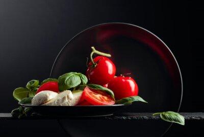 Mozzarella with tomato and green basil.