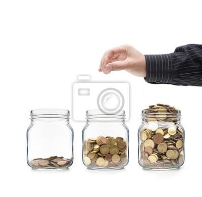 Münzen im Glas mit la main