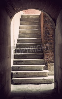 Papiers peints Mysterious ancient empty staircase in sepia