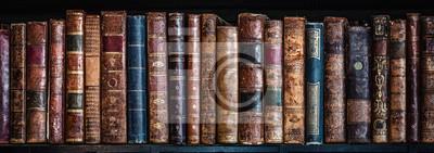 Papiers peints Old books on wooden shelf. Tiled Bookshelf background.  Concept on the theme of history, nostalgia, old age. Retro style.