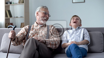 Papiers peints Old man and boy laughing genuinely, joking, valuable fun moments together