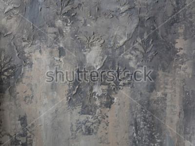 Papiers peints ornement sur un mur de béton gris