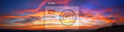Papiers peints Panorama colorful magnificent sunset in countryside above hills and fields, beauty nature background