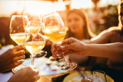 Papiers peints People clinking glasses with wine on the summer terrace of cafe or restaurant